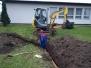 Stavba kanalizace ze střechy do rybníka na návsi